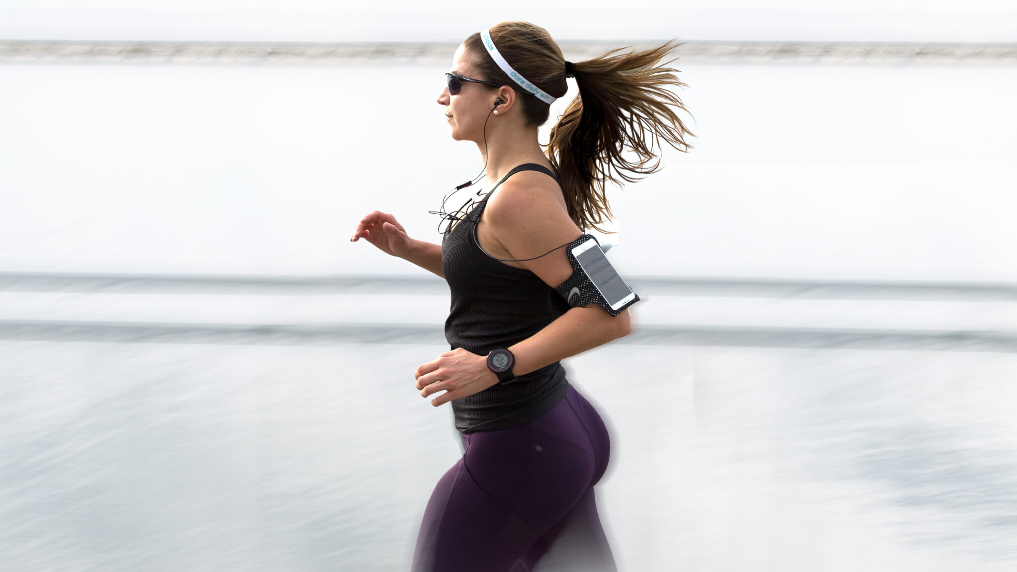 woman running with smart devices